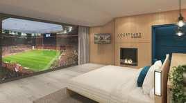 Una suite con camino dentro lo stadio del Bayern