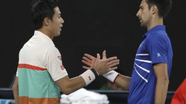 Tennis, Australian Open: si ritira Nishikori, Djokovic in semifinale con Pouille