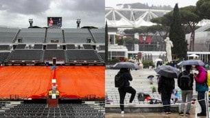 Roma, pioggia al Foro Italico: teloni in campo, tifosi sotto gli ombrelli