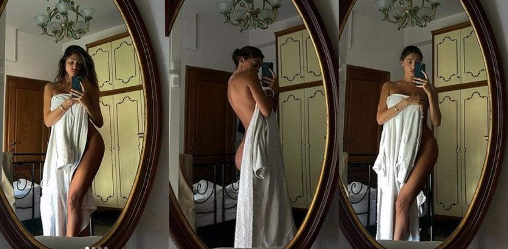 Belen Rodriguez, l'asciugamano scivola e svela il lato B