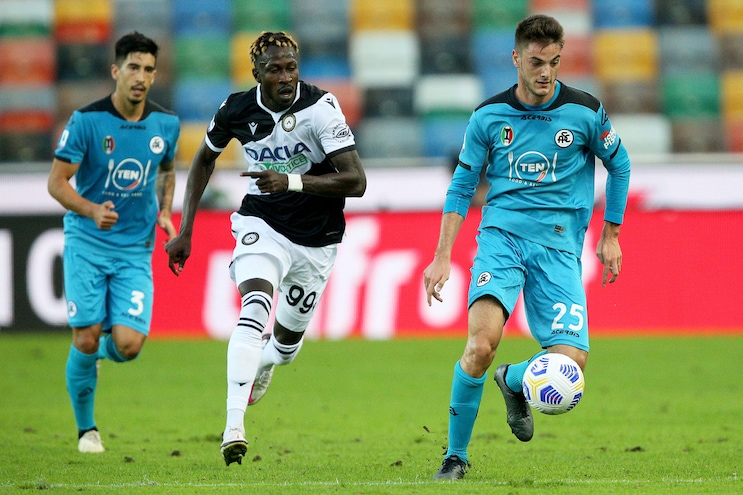 Soccer: Serie A; Udinese vs Spezia  Udinese's Mamadou Coulibaly (C) and Spezia's Giulio Maggiore (R) in action during the Italian Serie A soccer match Udinese Calcio vs Spezia ASC at the Friuli - Dacia Arena stadium in Udine, Italy, 30 September 2020. ANSA/GABRIELE MENIS